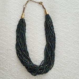 Iridescent purple and teal torsade necklace